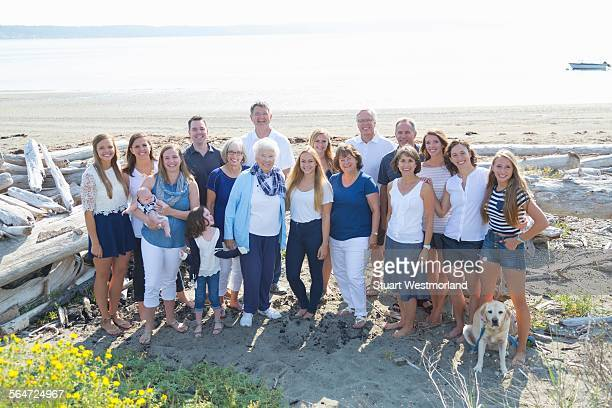 Portrait of four generation family on beach