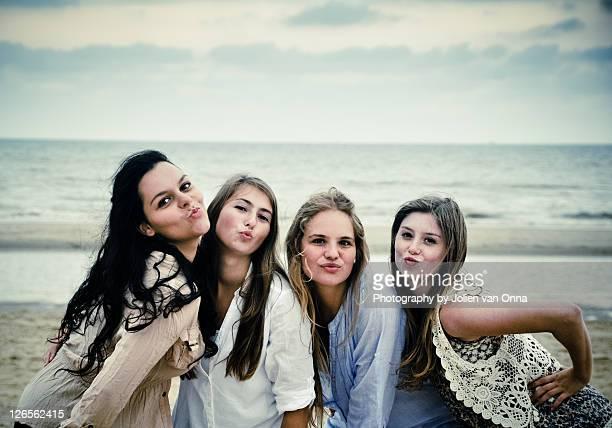 Portrait of four girl posing on beach
