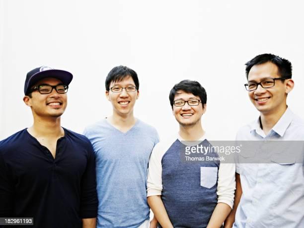 Portrait of four male friends smiling