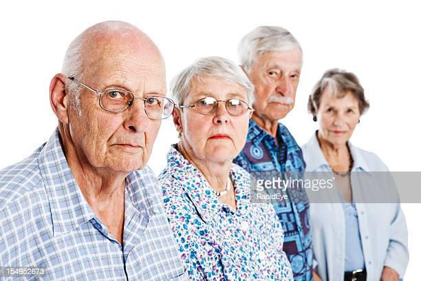 Portrait of four serious seniors