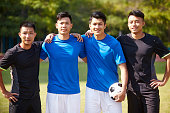 outdoor portrait of a team of young asian soccer football players