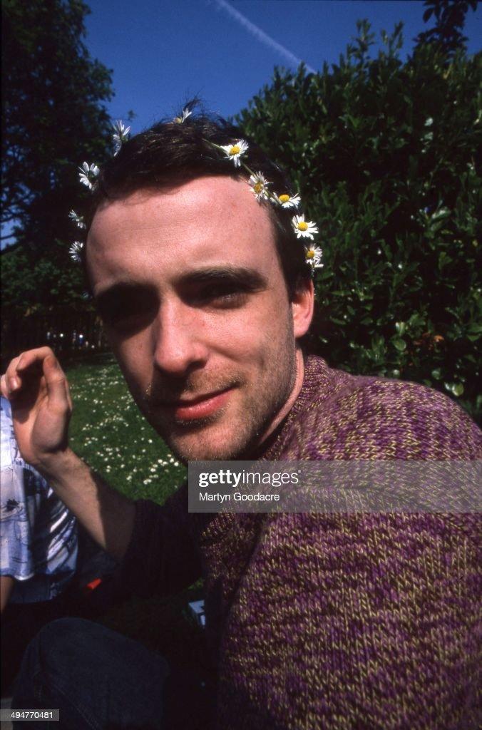 Portrait of Fran Healy of Travis wearing a daisychain Glasgow Scotland United Kingdom 1997