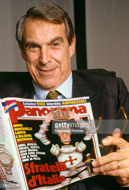 Portrait of Franco Tat Italian director of Arnoldo Mondadori publishing house In his hand a copy of the news magazine Panorama portraying a...