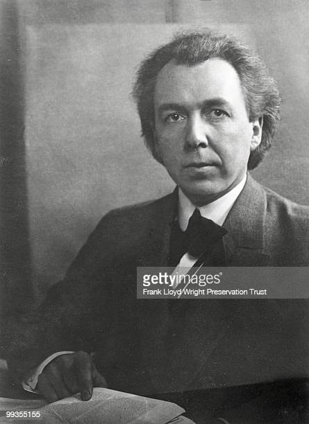 Portrait of Frank Lloyd Wright at approximately 38 with hand on book Oak Park Illinois ca 19041906
