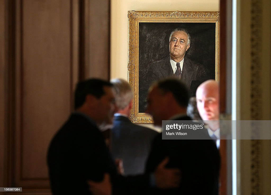 A portrait of Franklin Delano Roosevelt hangs in Senate Majority Leader Harry Reid's (D-NV) office as newly elected Democratic Senators arrive on November 14, 2012 in Washington, DC. Leader Reid hosted a meeting and photo op with the senators-elect.