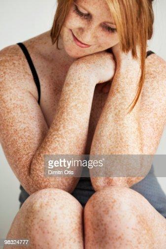 Portrait of freckled girl smiling