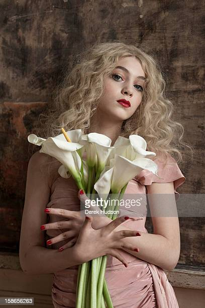 Portrait of French actress Anamaria Vartolomei as she holds a bouquet of lillies during a photo shoot Paris France April 13 2011 The shoot was in...