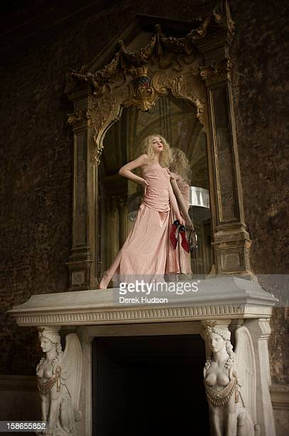 Portrait of French actress Anamaria Vartolomei stands atop a fireplace mantel during a photo shoot Paris France April 13 2011 The shoot was in...