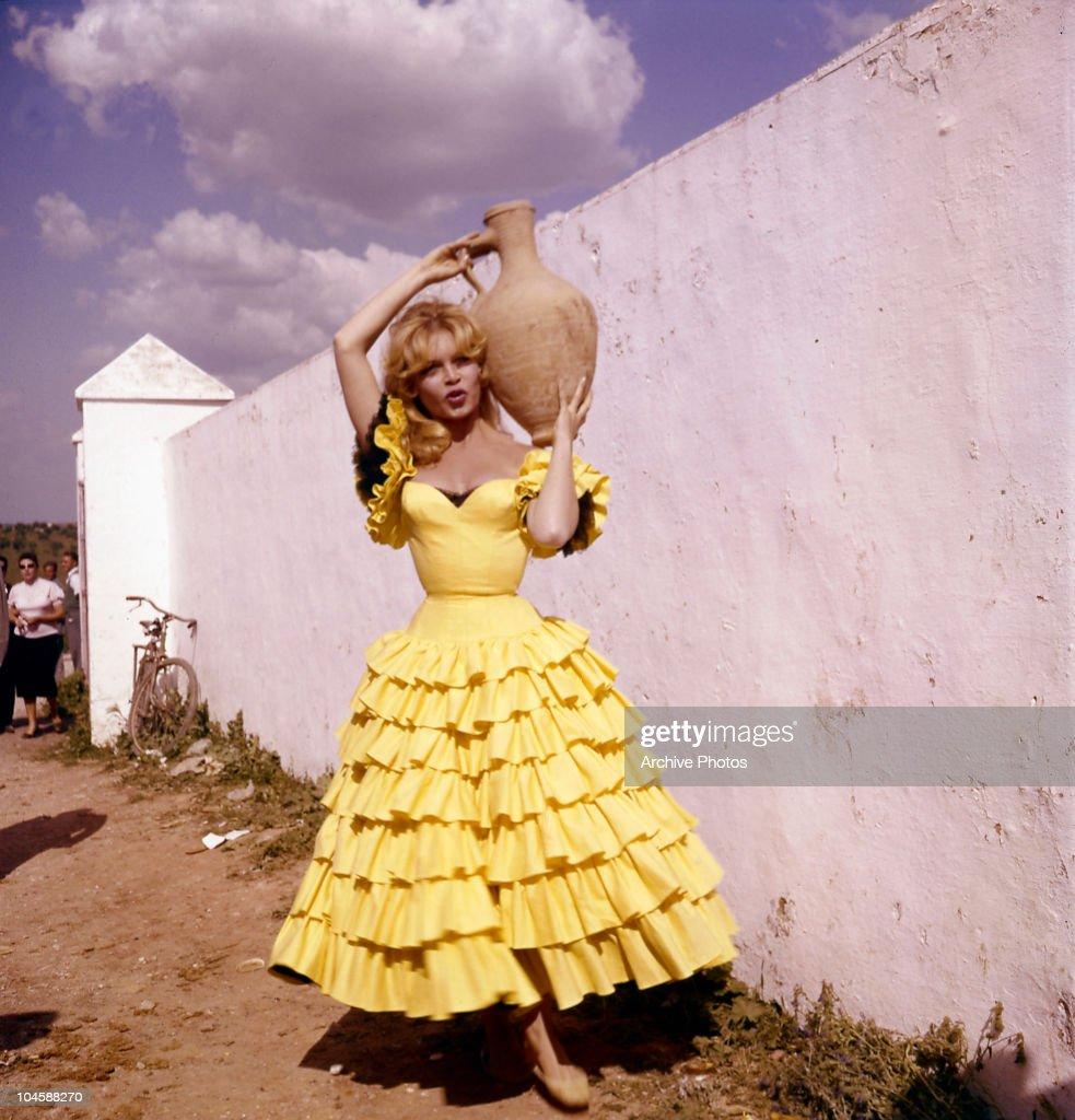 Portrait of French actress Brigitte Bardot in Spanish dress holding a jug circa 1960s