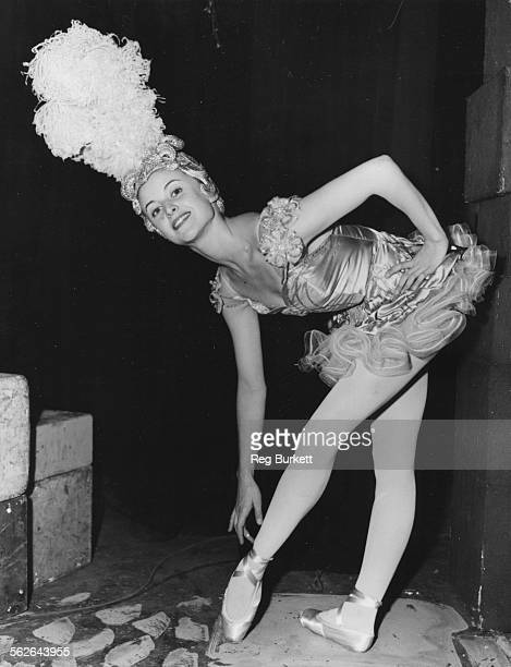 Portrait of French dancer Violette Verdy wearing a showgirl costume and large headdress during rehearsals for the television show 'Music For You' at...