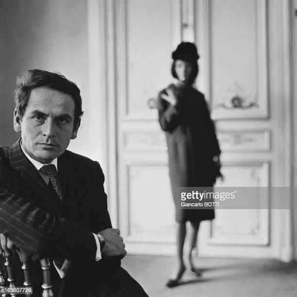 Portrait of French fashion designer Pierre Cardin circa 1960 One of his models in background