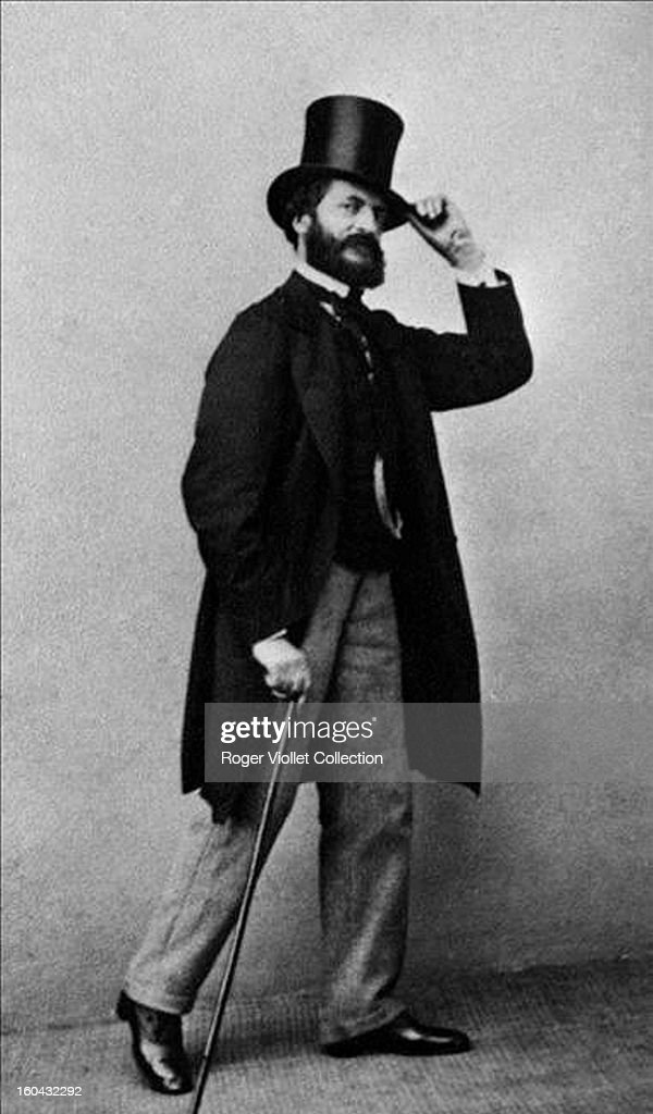 Portrait of French painter Edouard Manet (1832-1883) with top hat and cane circa 1865.