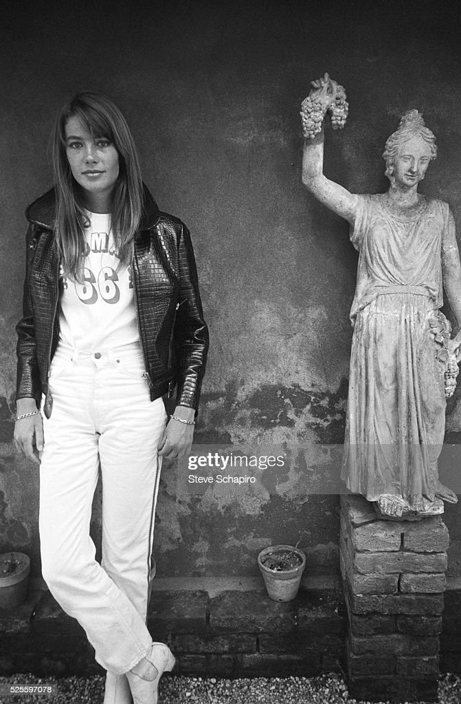 Portrait of French pop musician and actress <a gi-track='captionPersonalityLinkClicked' href=/galleries/search?phrase=Francoise+Hardy&family=editorial&specificpeople=941715 ng-click='$event.stopPropagation()'>Francoise Hardy</a> as she poses beside a statue, Venice, Italy, September 1966.
