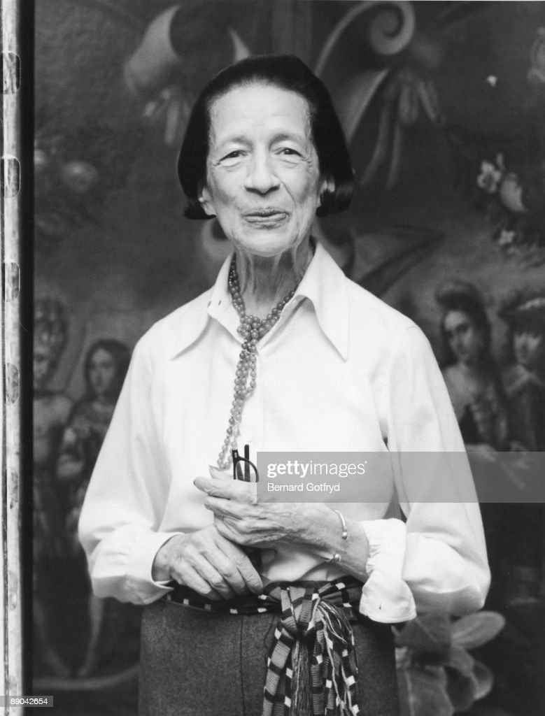 Portrait of French-born American fashion editor Diana Vreeland (1906 - 1989) as she stands with a pair of glasses in her hand, late 1970s or early 1980s.