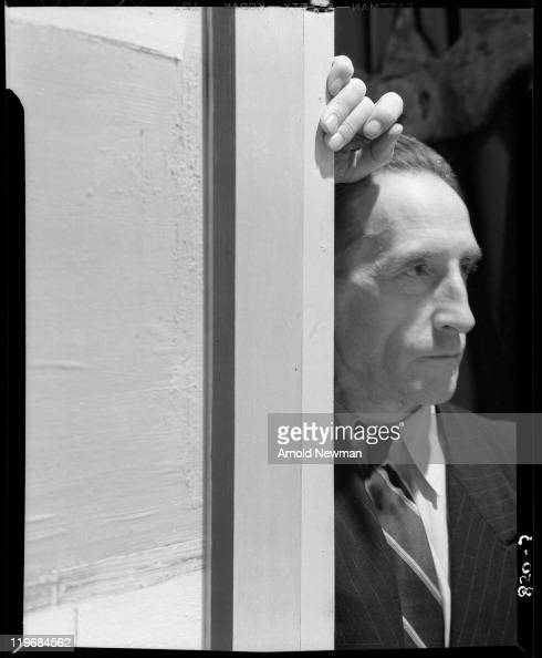 Portrait of Frenchborn artist Marcel Duchamp as he leans against a door to his 'First Papers of Surrealism' exhibition at the Whitelaw Reid mansion...
