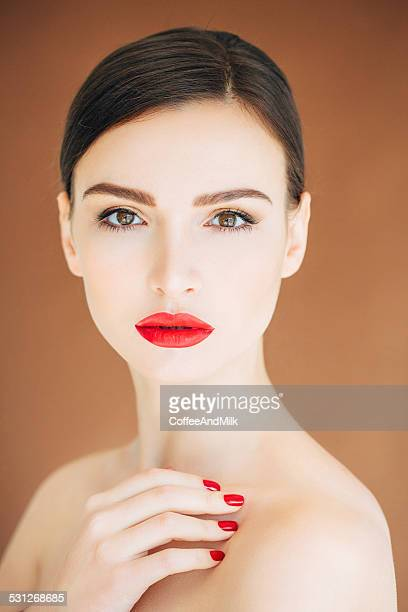 Portrait of fresh and lovely woman with red lips