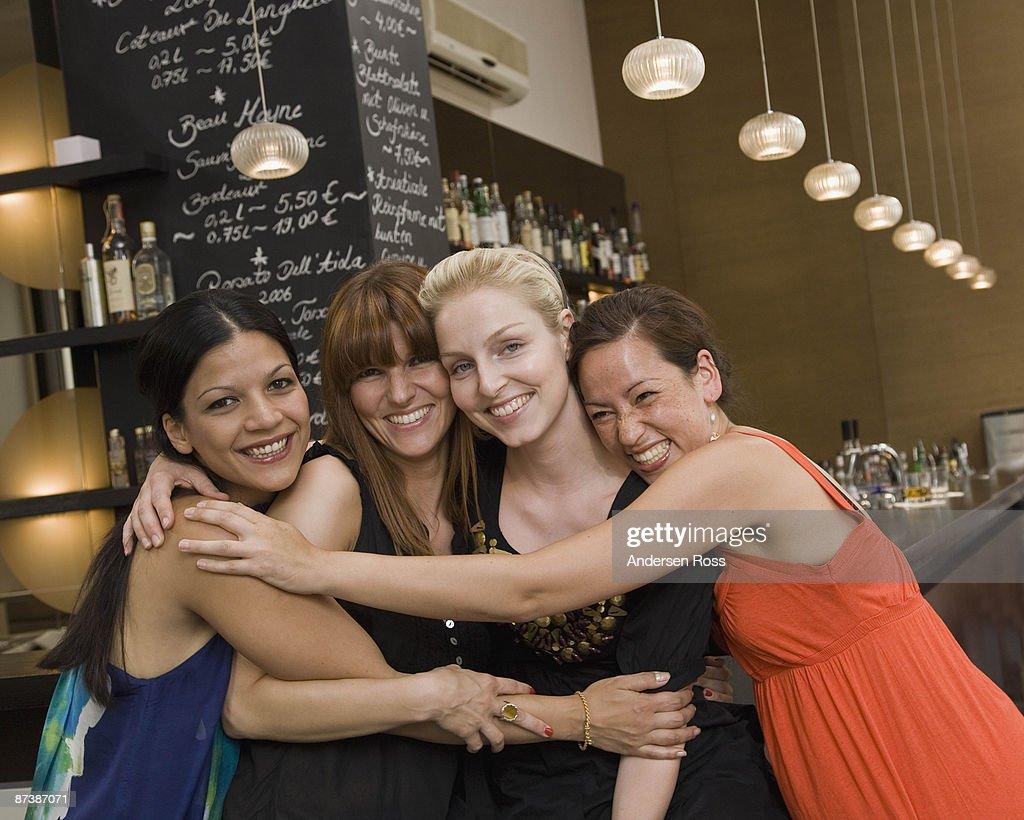 Portrait of friends at bar