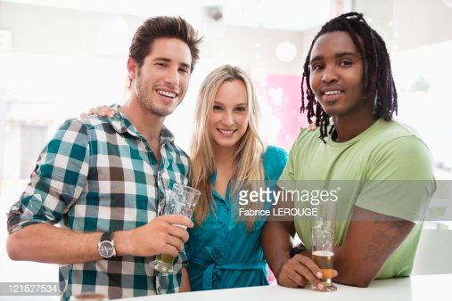 Portrait of friends having beer at a bar : Stock Photo