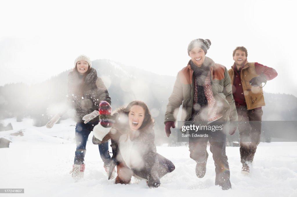 Portrait of friends playing in snowy field : Stock Photo