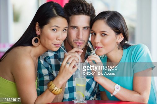 Portrait of friends sharing lime juice in a restaurant : Stock Photo