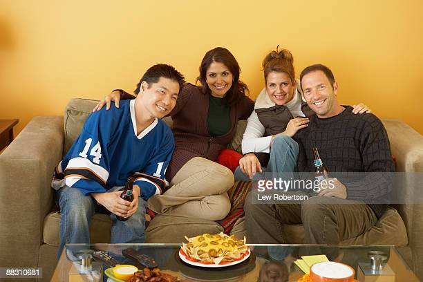 Portrait of friends sitting on couch