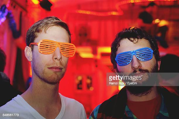 Portrait Of Friends Wearing Novelty Glasses