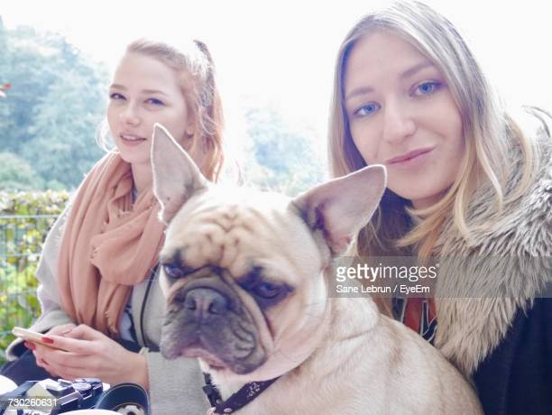 Portrait Of Friends With French Bulldog