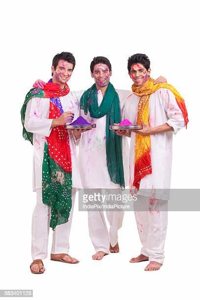Portrait of friends with holi colours