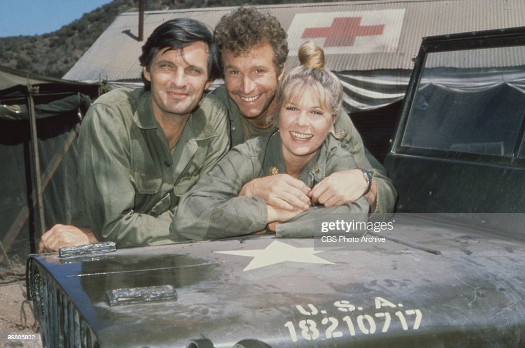 Portrait of, from left, American actors <a gi-track='captionPersonalityLinkClicked' href=/galleries/search?phrase=Alan+Alda&family=editorial&specificpeople=206416 ng-click='$event.stopPropagation()'>Alan Alda</a>, as Captain Benjamin Hawkeye Pierce, <a gi-track='captionPersonalityLinkClicked' href=/galleries/search?phrase=Wayne+Rogers+-+Actor&family=editorial&specificpeople=2014540 ng-click='$event.stopPropagation()'>Wayne Rogers</a>, as Captain Trapper John McIntyre, and <a gi-track='captionPersonalityLinkClicked' href=/galleries/search?phrase=Loretta+Swit&family=editorial&specificpeople=625446 ng-click='$event.stopPropagation()'>Loretta Swit</a>, as Major Margaret Houlihan, on the television series 'MASH,' California, 1972.