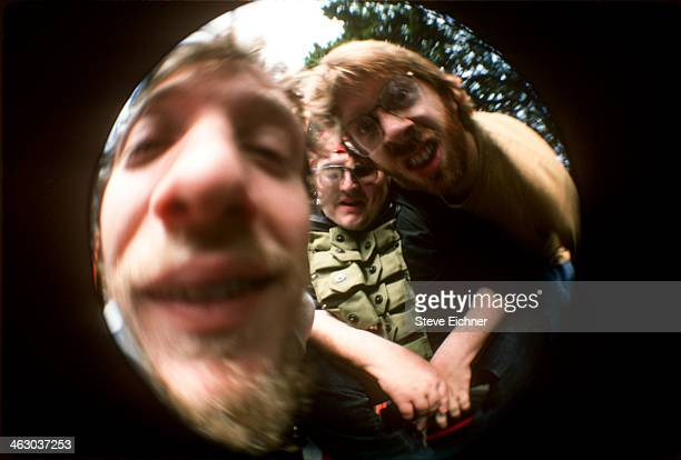 Portrait of from left American musicians Chris Barron of Spin Doctors John Popper of Blues Traveler and Trey Anastasio of Phish as they pose for a...