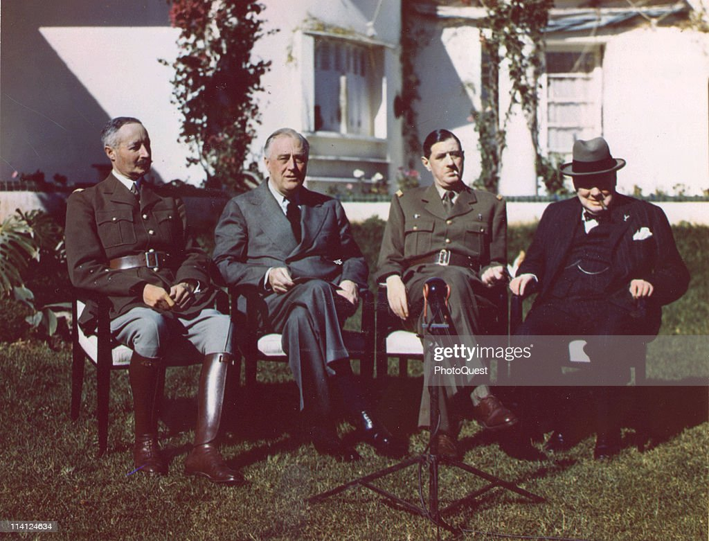 Portrait of, from left, French General Henri Giraud (1879 - 1949), the commandant in chief of the French Free forces based in the North Africa, American President Franklin Delano Roosevelt (1882 - 1945), French General Charles de Gaulle (1890 - 1970), the chief of French Free forces (and future French President), and British Prime Minister Sir <a gi-track='captionPersonalityLinkClicked' href=/galleries/search?phrase=Winston+Churchill+-+Prime+Minister&family=editorial&specificpeople=92991 ng-click='$event.stopPropagation()'>Winston Churchill</a> (1874 - 1965) as they sit outside the Anfa Hotel, Casablanca, Morrocco, mid-January, 1943. The men were in Morrocco for the Casablanca Conference (also known as the Anfa Conference), where they planned Allied strategy for the European campaign in World War II.
