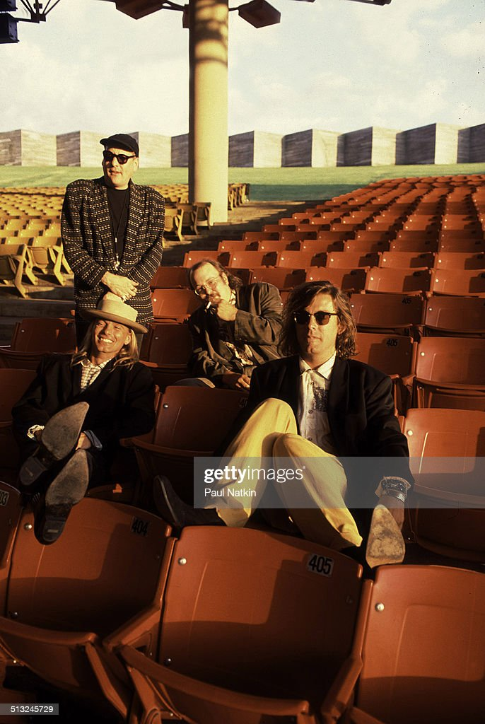 Portrait of from left Rick Nielsen Robin Zander Bun E Carlos and Tom Petersson of the band Cheap Trick as they pose in the grandstand at the Poplar...