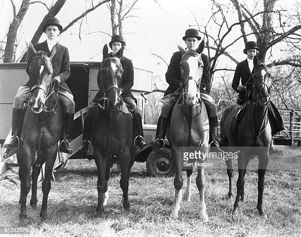 Portrait of from left sibblings Arthur K Watson Jane Watson Thomas J Watson Jr and Helen Watson all dressed riding clothes as they sit astride horses...