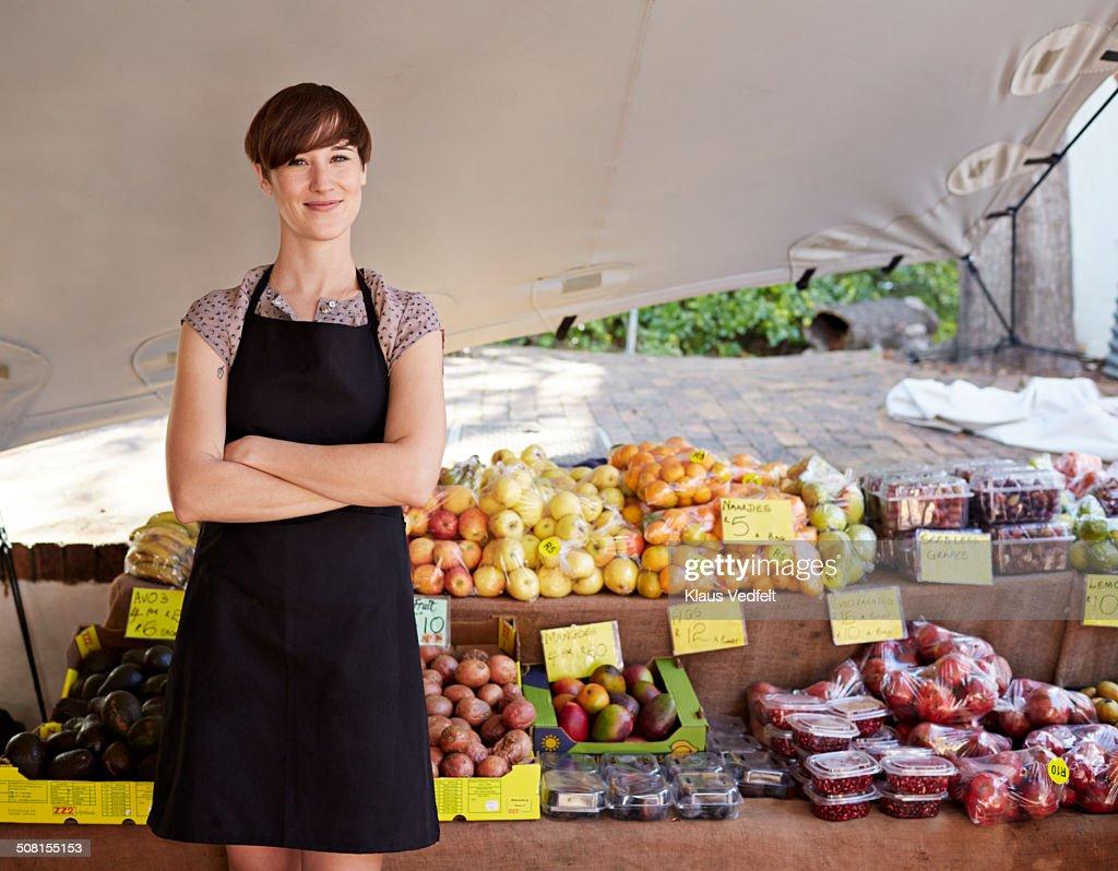 Portrait of fruit shop owner at farmers market