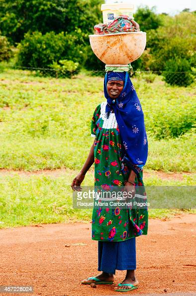 Portrait of Fulani woman carrying a big pumpkin on head