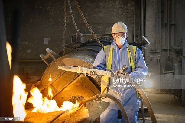 Portrait of furnace repair worker in protective clothing in steel foundry