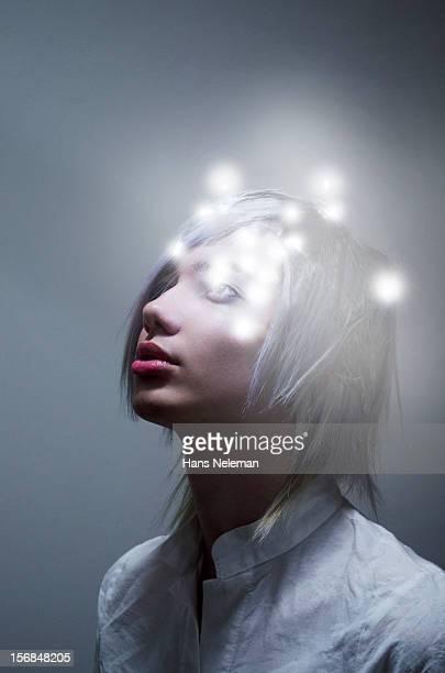 Portrait of futuristic man looking up