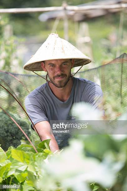 Portrait of gardener with Asian hat