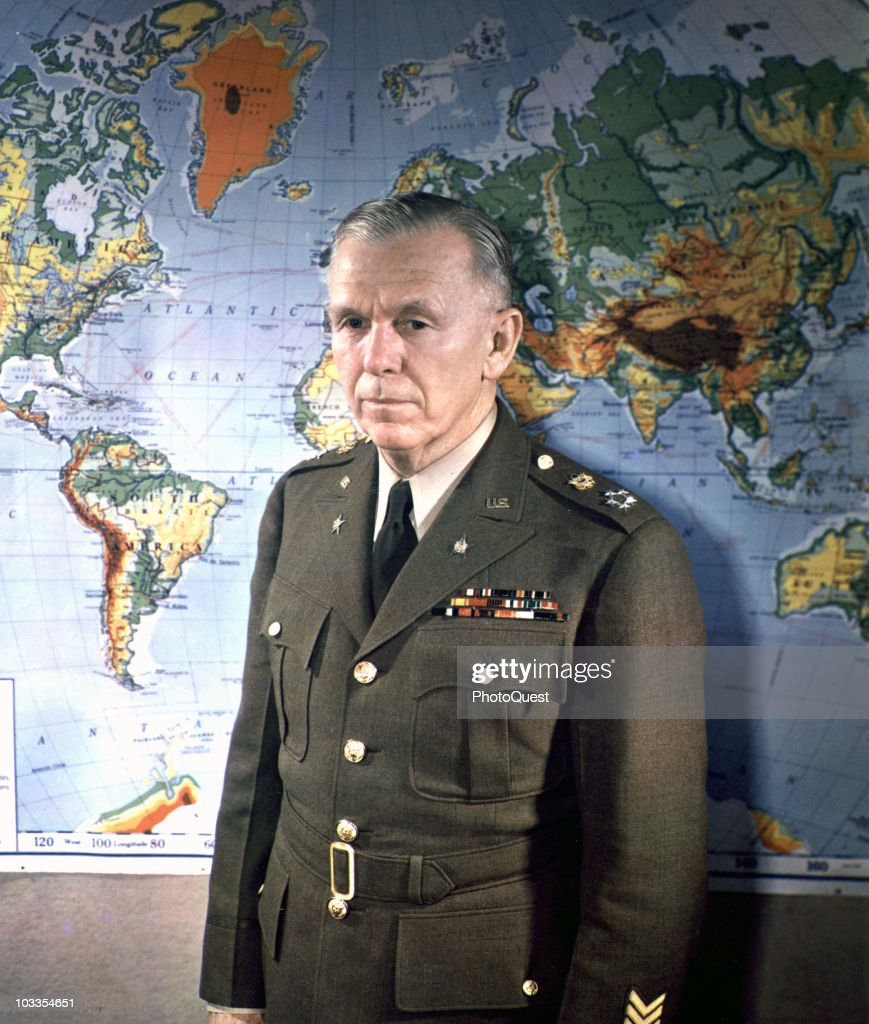 Portrait of General George C Marshall General of the Army standing in front of a world map Washington DC 1945