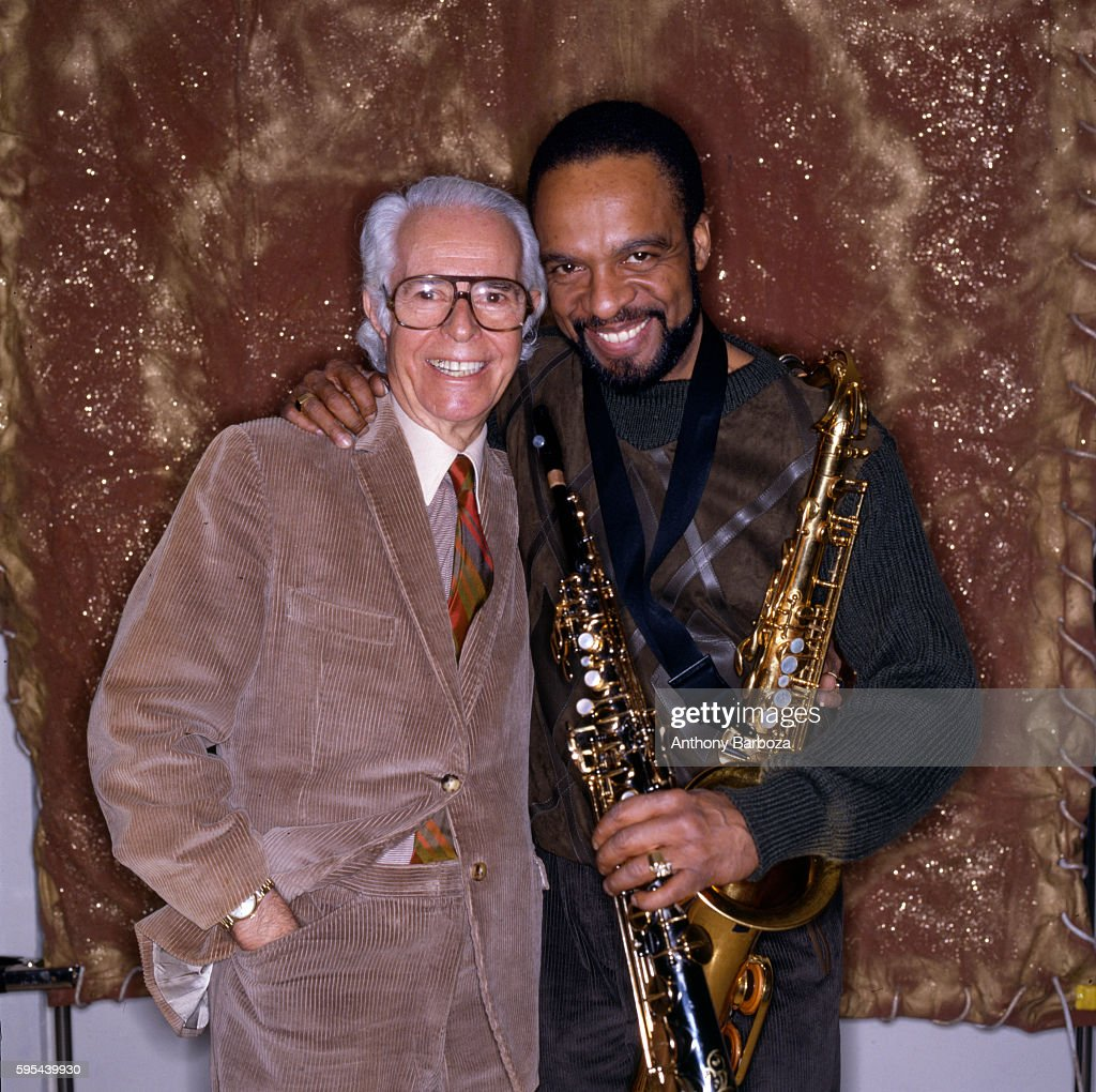 Portrait of Germanborn American music executive Alfred Lion and Jazz musician Grover Washington Jr as they pose together backstage at the Blue Note...