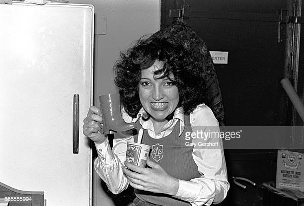 Portrait of Germanborn American musician Karla DeVito with a bootshaped mug and a yogurt as she poses at a rehearsal loft New York New York November...