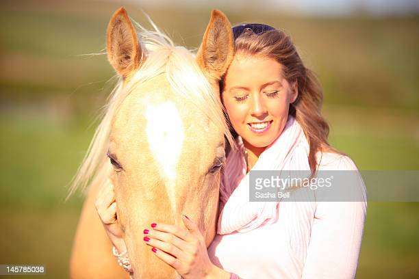 Portrait of girl and palomino horse