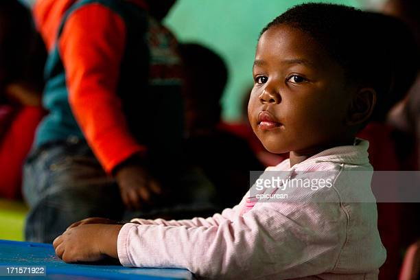 Portrait of girl at class in rural South Africa kindergarten