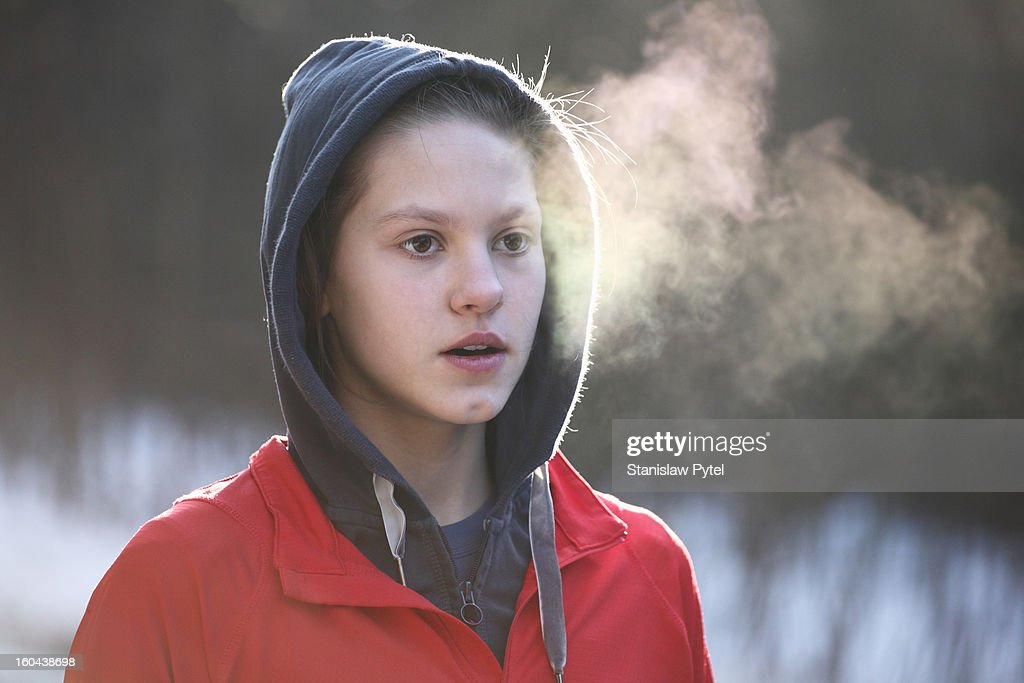Portrait of girl breathing during morning jogging