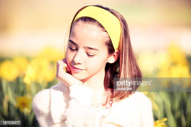 Portrait of girl by daffodils
