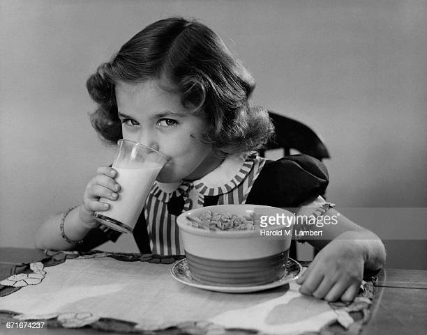 Portrait Of Girl Drinking Milk