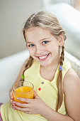 Portrait of girl drinking orange juice