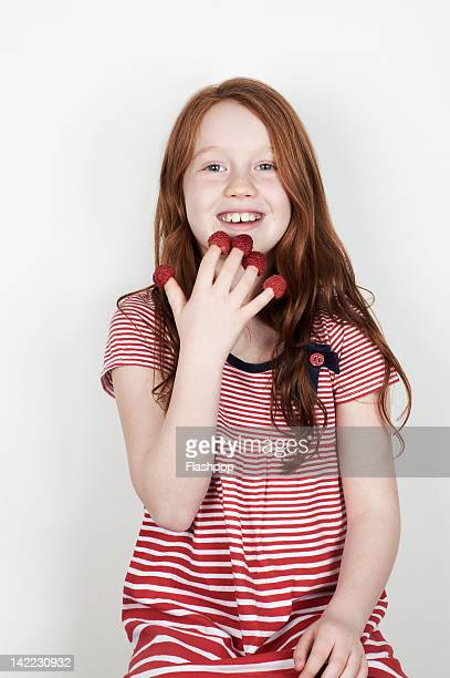 Portrait of girl eating fruit