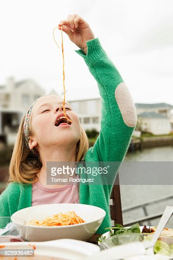 Portrait of girl (8-9) eating pasta : Stock Photo