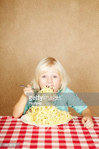 Portrait of girl eating spaghetti : Stock Photo
